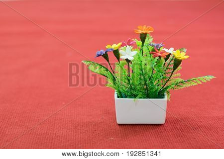 Fake Flower In The White Flowerpot   On The Red Floor, The Fake Flower Can In The Important Work