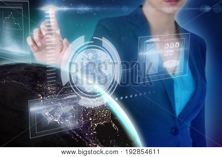 Cropped image of businesswoman using imaginative digital screen against blue background with vignette