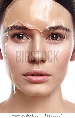 Studio Portrait Of Beautiful Woman With Natural Makeup With Transparent Gel On Her Face