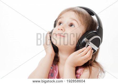 The Little Girl Listens To Music