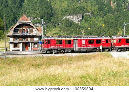 Cavaglia Switzerland - 21 July 2015: People waiting to take the Bernina express train at the station of Ospizio Bernina on the Swiss alps