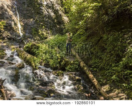 Man hiking at Mingo Falls in the Great Smoky Mountains