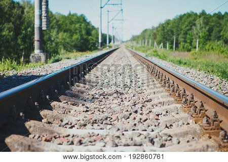 Railway track to the up country. Railway rail close-up background wallpaper.