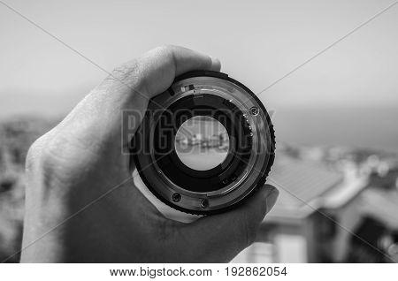 a nikon 50mm lens in front of a landscape