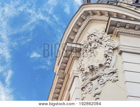 Historic building detail with blue cloudy sky