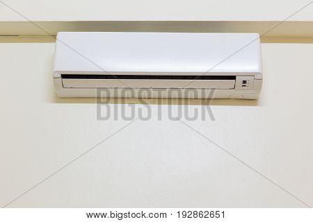 Air conditioner part of HVAC system inside room.