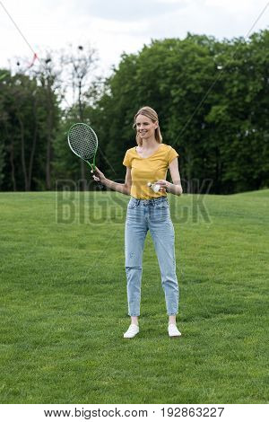 Attractive Woman Standing With Badminton Racquet And Shuttlecock And Ready To Play