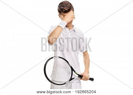 Teenage tennis player holding his head in disbelief isolated on white background
