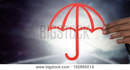 hand holding a red umbrella against road against cloudy sky in stormy weather with graphs