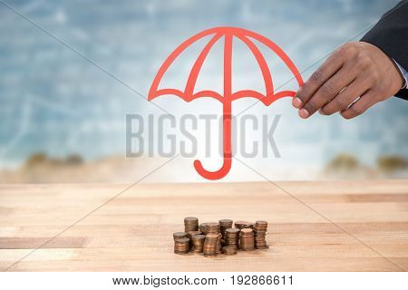 hand holding a red umbrella against road and graphs with numbers