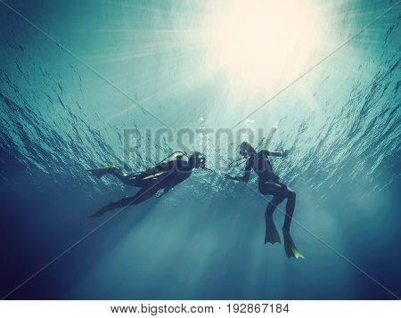 Scuba divers underwater. This is a 3d render illustration
