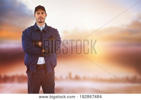Security standing with arms crossed against cityscape on the horizon