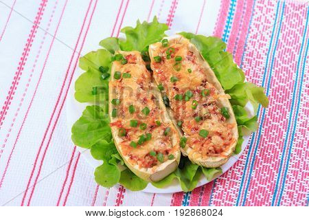 The Green Vegetable Marrows Stuffed With Chicken With Cheese And Greens