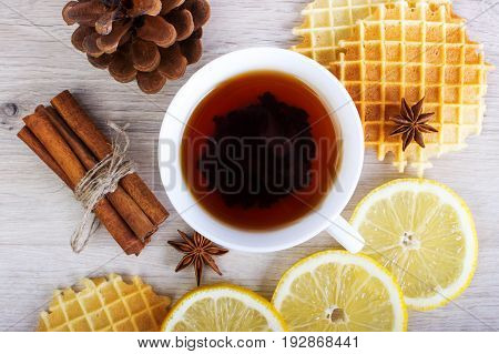 Cup Of Black Tea With Christmas Decor, Lemon, Pinecone, Waffles, Badian And Cinnamon