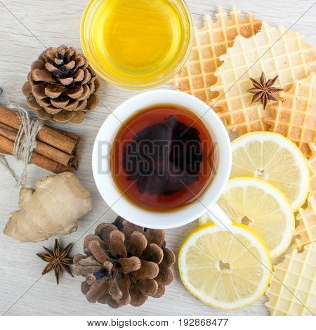 Cup Of Tea With Cinnamon, Honey, Pinecone, Ginger, Badian And Waffles