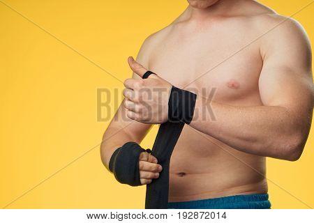 Athlete on a yellow background, elastic bandage, sports, fitness.
