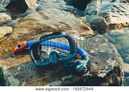 Mask For Diving And Snorkel Lie On The Beach On The Rocks. Tourism And Travel Concept