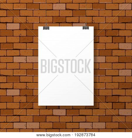 One hanged horizontal paper sheet frame with clips on weathered red brick wall background. Can be used as mockup
