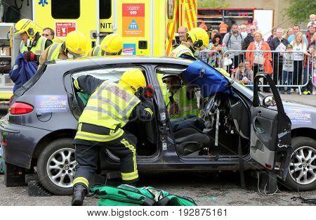 Beaulieu, Hampshire, Uk - May 29 2017: Firemen And Paramedics At Work  During A Vehicle Rescue Demon