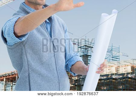 Digital composite of engineer at construction