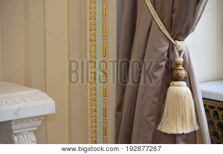 Luxury silk curtain and tassel, close up