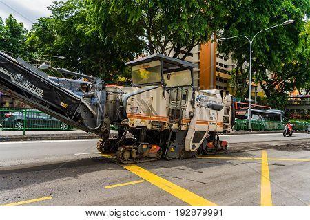 Bitumen And Asphalt Paver Machine On The Road