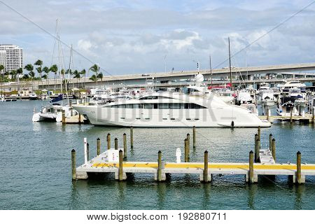Downtown Miami along Biscayne Bay with condos yacht docked in the bay at summer day