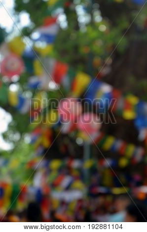 blurred Background of festival lunghta flag and Paper lantern on Bodhi tree a place of Buddha enlightenment