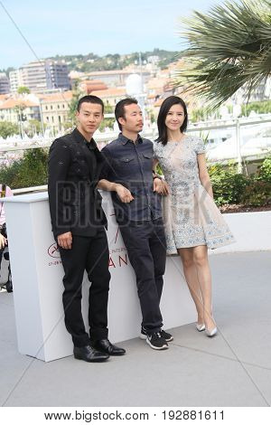 Yang Zishan, Li Ruijun, Yin Fang attend the 'Walking Past The Future (Lu Guo Wei Lai )' photocall during the 70th Cannes Film Festival at Palais des Festivals on May 21, 2017 in Cannes, France.