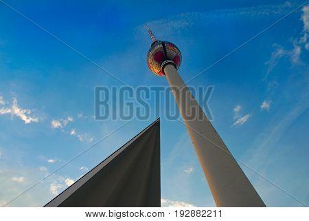 BERLIN SEP 18 2006: Evening underside view on Alexander platz tower Berliner Fernsehturm Berlin symbol and museum roof. Abstract triangle geometry Berlin architecture. Blue sky. Sightseeing holidays