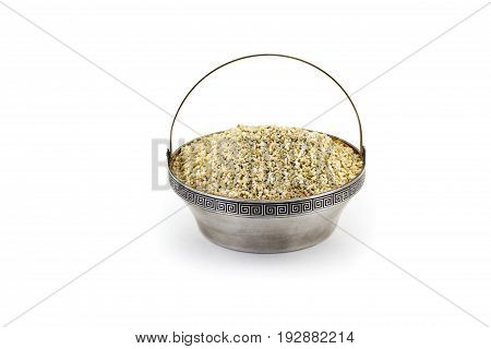Raw dry Barley in sulver bowl isolated on white