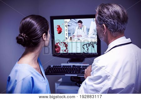 uniformed doctor analyzing the heart against doctor and nurse examining x-ray on computer