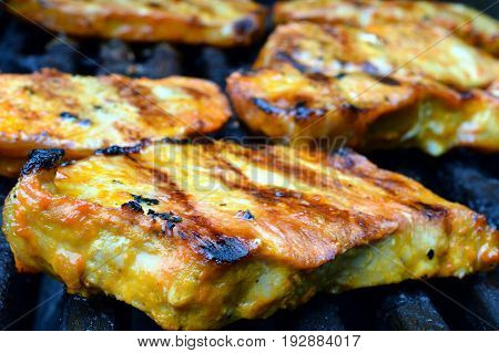 Pork steaks on a gas grill. Horizontal image