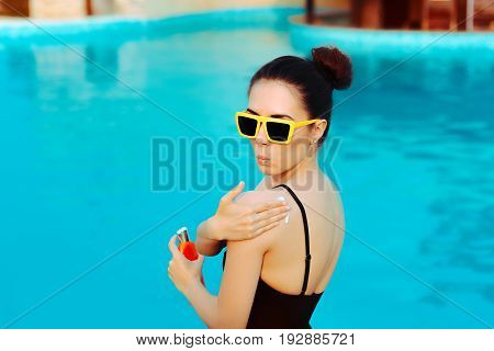 Summer Girl Applying Suncream Lotion by the Pool