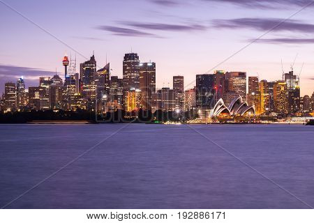 Sydney's famous icon The Sydney Opera House and Central Business District of Sydney in the moment of twilight. Photographed in Sydney Australia on 17 March 2016.