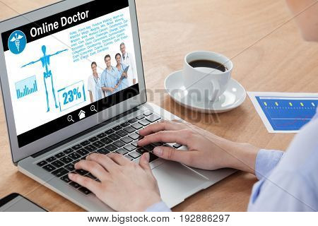 health information online against close-up of businesswoman using laptop