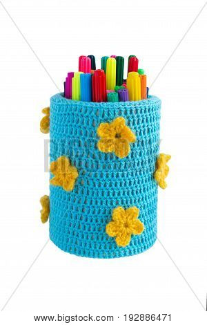 Colored felt tip pens in a knit case white background isolated