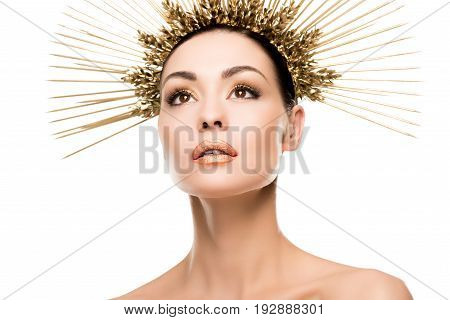 Portrait Of Fashionable Woman Posing In Golden Headpiece Isolated On White