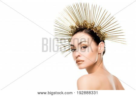 Seductive Woman Wearing Golden Headpiece And Looking At Camera Isolated On White