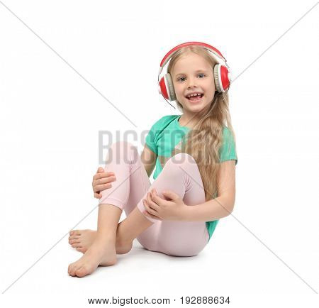 Cute funny girl with headphones listening to music on white background
