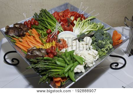 Vegetable Plate Arrangement with Green Beans, Cauliflower, Tomatoes, Broccoli, and Egg Plant