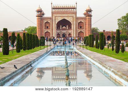Agra India - April 30 2017 : Taj Mahal's western gate at sunrise Agra India