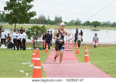 Nakhon nayokThailand - 25 June 2017: Woman swimmer run from pool to transition area in Challenge Nakhon Nayok 2017