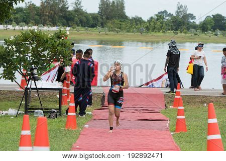 Nakhon nayok Thailand - 25 June 2017: Woman swimmer run from pool to transition area in Challenge Nakhon Nayok 2017