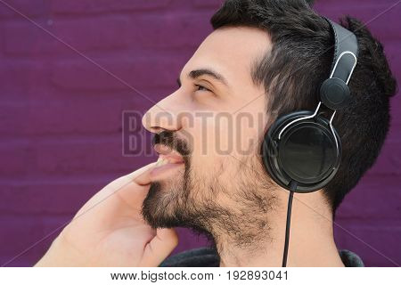 Latin Man Listening Music With Headphones.