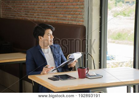 Businessman Thinking Ideas Strategy Working Concept/Thinking businessman in the cafe looking through the window