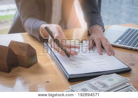 Close Up Business Man Waiting Signing Agreement Contract. Real Estate And Agreement Concept.