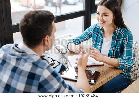 Do you agree. Positive easygoing intelligent guy inviting his friend for a cup of coffee for discussing some details of their common project