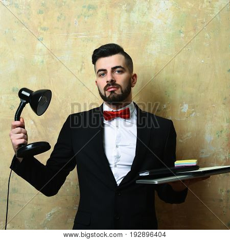 Ceo With Confident Face Expression Holds Lamp And Laptop