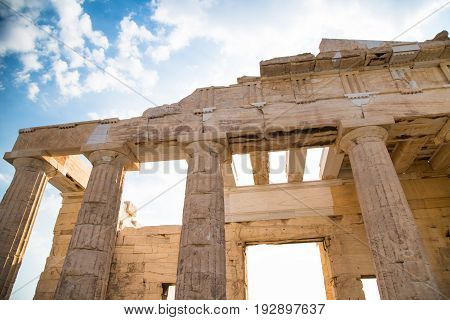 Propylaea of the Acropolis Athens Greece. Ancient Architecture against blue sky and clouds.